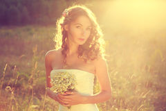 Stylish Young Bride Outdoors at Sunset Royalty Free Stock Photos