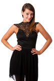 A stylish young brunette woman in black dress in little black dr Stock Photos