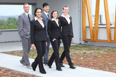 Stylish young business team walking together Royalty Free Stock Image