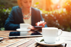 Stylish young business vumen breakfast on the balcony fashionable expensive hotel Royalty Free Stock Image
