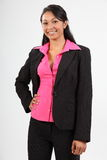 Stylish young business woman wearing dark suit Stock Photo