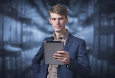 Stylish young businessman holding a tablet Stock Photography