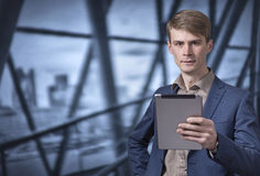 Stylish young businessman holding a tablet Royalty Free Stock Image