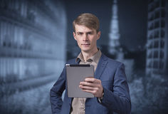 Stylish young businessman holding a tablet Stock Photo