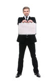 Stylish young businessman with metal suitcase. Full length. Stock Image