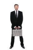 Stylish young businessman with metal suitcase. Full length. Royalty Free Stock Images