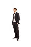 Stylish young businessman standing thinking Stock Photography