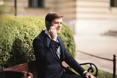 Stylish young businessman talking on the phone outdoors Royalty Free Stock Photography