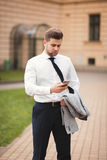 Stylish young businessman talking on the phone outdoors Stock Photography