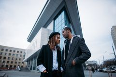 Stylish young couple. African American youth. On urban backdrop. Fashionable models on street, sky background, beauty concept Stock Images