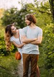 Stylish young couple. Film photo. Appearance and clothes for a photo shoot of a love story. The girl hugs the guy royalty free stock photography