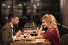 Stylish young couple have fun and eating. Wearing trendy outfit. stock photography