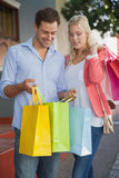 Stylish young couple on a shopping trip Stock Photography