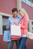 Stylish young couple on a shopping trip Royalty Free Stock Images