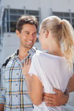 Stylish young couple smiling at each other Royalty Free Stock Image