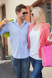 Stylish young couple standing with shopping bags Stock Photography