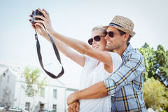 Stylish young couple taking a selfie Stock Photos
