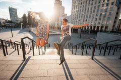 Stylish young couple teenagers in love in the city, summer sunny day Stock Photo