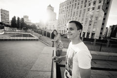 Stylish young couple teenagers in love in the city, summer sunny day Royalty Free Stock Photos