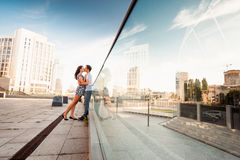 Stylish young couple teenagers in love in the city, summer sunny day Stock Photos