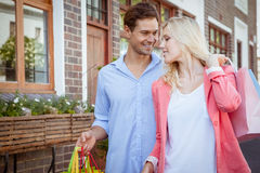 Stylish young couple walking with shopping bags Royalty Free Stock Image