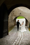 Stylish young fashion groom and bride on the background old vien Royalty Free Stock Photos