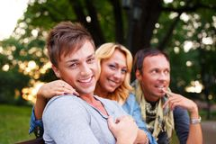 Stylish young friends. Group of stylish friends in a park on summer day stock photo
