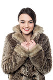 Stylish young girl in fur jacket Stock Images