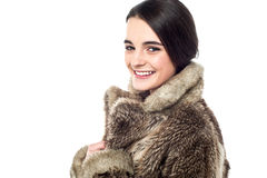 Stylish young girl in fur jacket Royalty Free Stock Photography