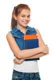 Stylish young girl in a jeans vest and denim shorts with books in hands. Schoolgirl with textbooks. Street style teenager, lifesty Stock Image