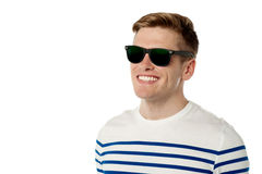 Stylish young guy in black sunglasses Royalty Free Stock Photography
