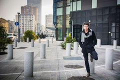 Stylish Young Handsome Man in Black Coat Standing Royalty Free Stock Image