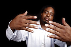 Stylish young man. Portrait of a stylish young black man gesturing with his hands Stock Photo