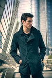 Stylish Young Man in Black Coat in City Center Street Stock Images