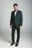 Stylish young man with black suit and bow. Stock Photo