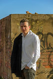 Stylish Young Man with Cats and Graffiti Royalty Free Stock Photos