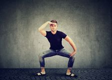 Stylish young man in denim clothing dancing stock photography