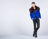 Stylish young man in fashion pose Stock Image