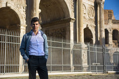 Stylish young man in front of Arco di Costantino, Rome, Italy Royalty Free Stock Photos