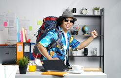 Stylish Young Man Ready to Go Travel. Carrying Big Backpack at O Stock Image