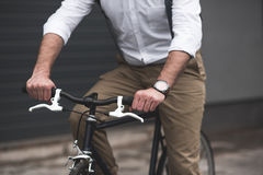 Stylish young man riding bicycle Royalty Free Stock Images