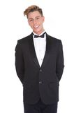 Stylish young man smiling in tuxedo Stock Photos