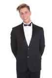 Stylish young man smiling in tuxedo Stock Photos