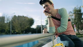 Stylish young man in the street talking on the phone in the city. stock video footage