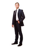 Stylish young man in suit and tie. Business style. Handsome man standing and looking at the camera Stock Images