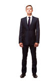 Stylish young man in suit and tie. Business style. Handsome man standing and looking at the camera Stock Image