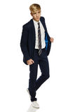 Stylish young man in suit walking Royalty Free Stock Photos