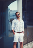 Stylish young man. In sunglasses and shorts Stock Photos
