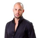 Stylish young man wearing black shirt and looking at camera Royalty Free Stock Photo