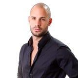 Stylish young man wearing black shirt and looking at camera Royalty Free Stock Images